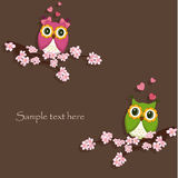 Owls on the tree. With hearts stock illustration