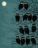 Owls on a tree. Vector image of a pack of the owls on a tree in the night stock illustration