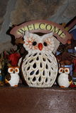 Owls welcoming autumn. Ceramic owls composition. Autumn colors, brown, white, orange and  with a stone background Stock Photos