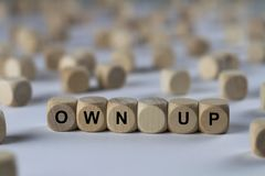 Own up - cube with letters, sign with wooden cubes Stock Images