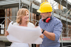 Owner And Architect Analyzing Blueprint Stock Photography