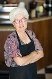 Owner With Arms Crossed Standing In Cafeteria Royalty Free Stock Photos