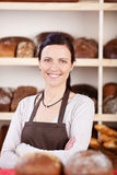 Owner of a bakery standing with folded arms Stock Photography