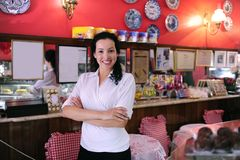 Owner of a cafe/ pastry shop. Proud and confident owner of a cafe/ pastry shop royalty free stock photo