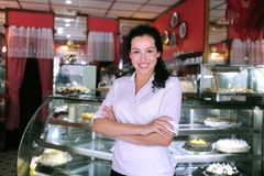 Owner of a cafe/ pastry shop. Proud and confident owner of a cafe/ pastry shop royalty free stock image