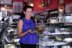 Owner of a cafe/ pastry shop. Proud and confident owner of a cafe/ pastry shop Stock Image
