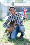 Owner and champion dog with golden medals