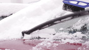 Owner cleans his car from the snow. stock footage