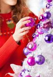 Owner Decorating Christmas Tree With Balls Royalty Free Stock Photo