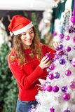 Owner Decorating Christmas Tree Stock Images