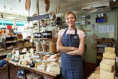 Owner Of Delicatessen Standing In Shop Royalty Free Stock Images