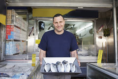 Owner Displaying Fresh Fish In Store Stock Images