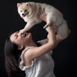 Owner embracing her pet dog Stock Photography