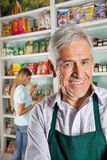 Owner With Female Customer Shopping In Background Stock Photos