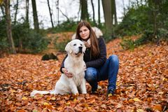 Owner girl and her golden retriever hugging outdoors royalty free stock photography