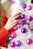 Owner Hanging Balls On Christmas Tree Royalty Free Stock Images
