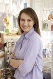Owner Of Homeware Shop Standing In Doorway Stock Images