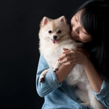 Owner hugging her pet dog Stock Images