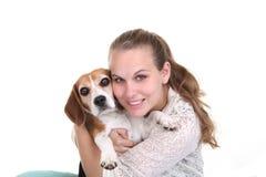 Owner hugging pet Beage dog. Happy owner hugging pet Beage dog royalty free stock images