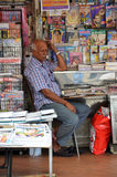 Owner of Indian magazines store in Little India, Singapore Stock Images