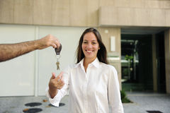 Owner of a new apartment: Woman receiving the keys Royalty Free Stock Photography