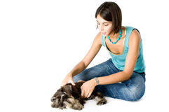 Owner playing with puppy. Pretty owner playing with her puppy royalty free stock photos