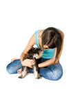 Owner playing with puppy. Pretty owner playing with her puppy royalty free stock photography
