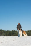 Owner with rescue dog in snow Royalty Free Stock Photo