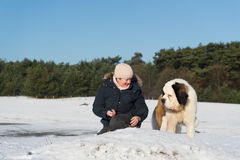 Owner with rescue dog in snow Royalty Free Stock Photos