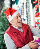 Owner In Santa Hat Working At Christmas Store Stock Photos
