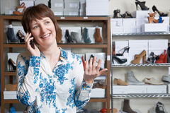 Owner Of Shoe Store On Phone Stock Photography