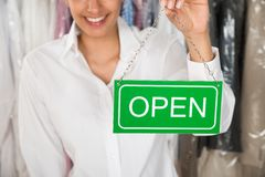 Owner showing open sign Royalty Free Stock Images