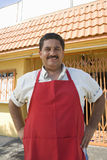 Owner Standing Outside Restaurant. Portrait of Hispanic Latin male restaurant owner standing with hands on hips royalty free stock photo