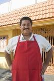 Owner Standing Outside Restaurant royalty free stock photo