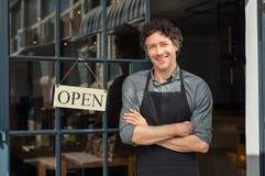 Owner standing outside restaurant stock image