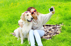 Owner woman with Golden Retriever dog taking selfie portrait Royalty Free Stock Images