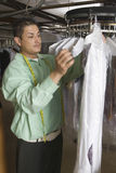 Owner Working In Laundry Royalty Free Stock Image