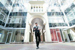 The owner of the world. Confident businessman standing in the mi Stock Photography