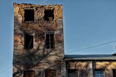 Ownerless tower. The building collapses from above, below people still work Royalty Free Stock Photo