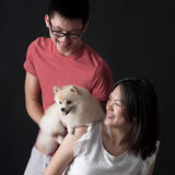 Owners bonding with pet dog Stock Photo