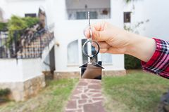 Ownership, property and tenant concept - key in hand for new home and real estate stock images