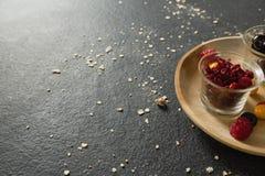 Owoc i wysuszone owoc w drewnianym talerzu Obrazy Royalty Free