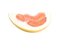 Owocowy pomelo kłama na białym tle Soczysta czerwona braja obraz stock