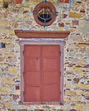 Ox-eye window, old house detail Royalty Free Stock Photo