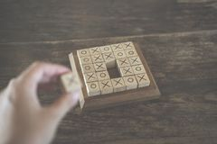 Ox tic-tac-toe game made by wood block on wooden table. educatio. Ox tic tac toe game made by wood block on wooden table. risk, strategy, competiton in business Stock Images