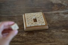 Ox tic-tac-toe game made by wood block on wooden table. educatio. Ox tic tac toe game made by wood block on wooden table. risk, strategy, competiton in business Stock Photos