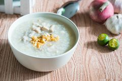 Ox tripe congee. Or also known as goto best topped with fried garlic and calamansi juice royalty free stock images