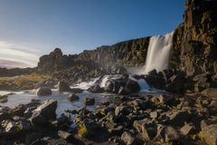 Oxararfoss waterfall in Iceland. Long exposure of flowing water at Oxararfoss waterfall at Thingvellir National Park, Iceland Stock Photo