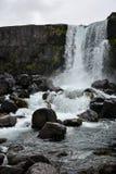 Oxararfoss waterfall in Pingvellir or Thingvellir National Park Royalty Free Stock Photography