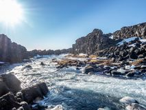 Oxararfoss waterfall in winter of Iceland. Oxararfoss, the strong waterfall in Thingvellir national park, in winter season with ice and snow in water, surrounded Royalty Free Stock Photography